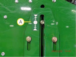 Assegure de que os rolos estão baixos e o pino está na zona indicada pela decalque.